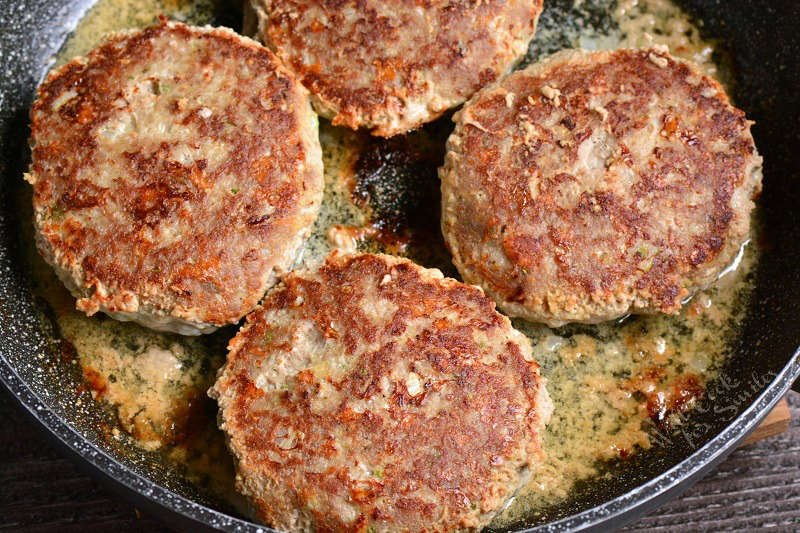 turkey burgers cooking in a pan
