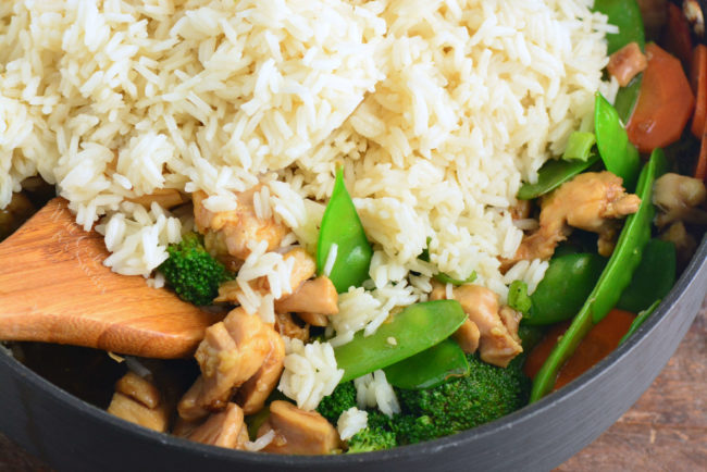 add rice to chicken and vegetables