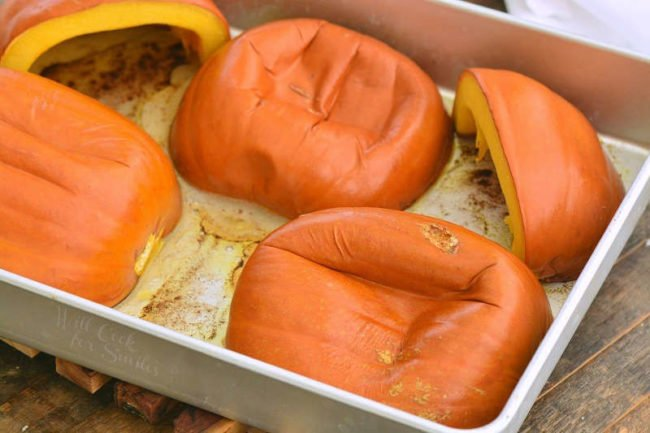 baked pumpkin halves in a baking pan