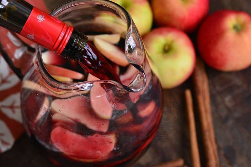 pouring red wine into the jar