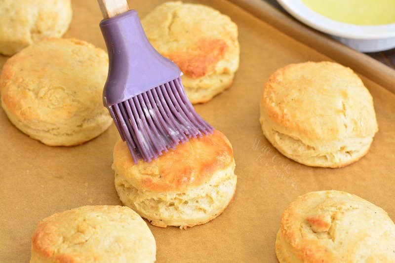 brushing biscuits with butter