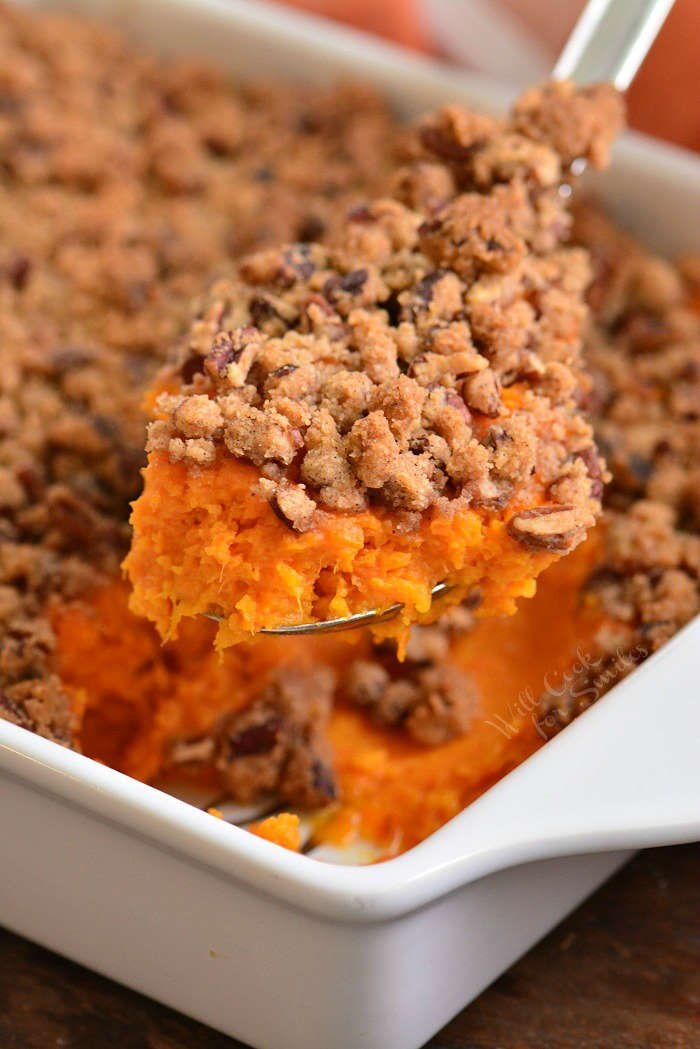 scooping sweet potato casserole
