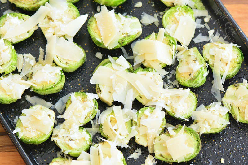 brussels sprouts with parmesan cheese on top