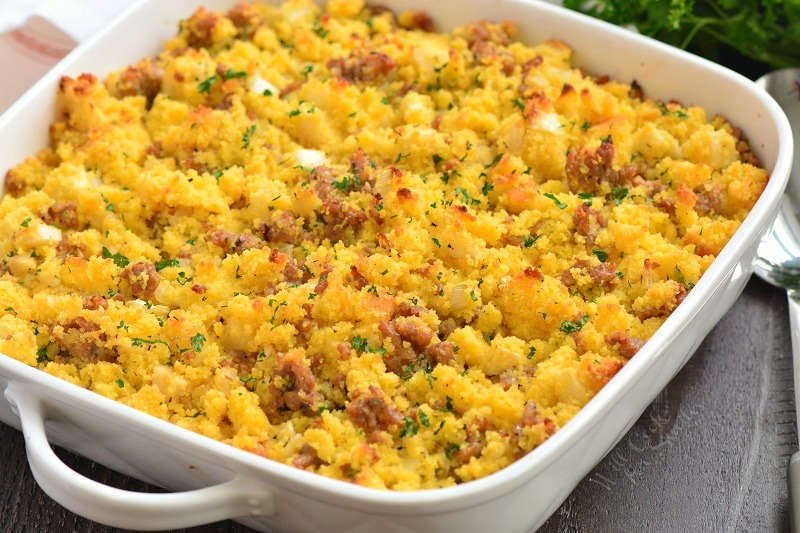 cornbread dressing in a casserole dish on a wood table