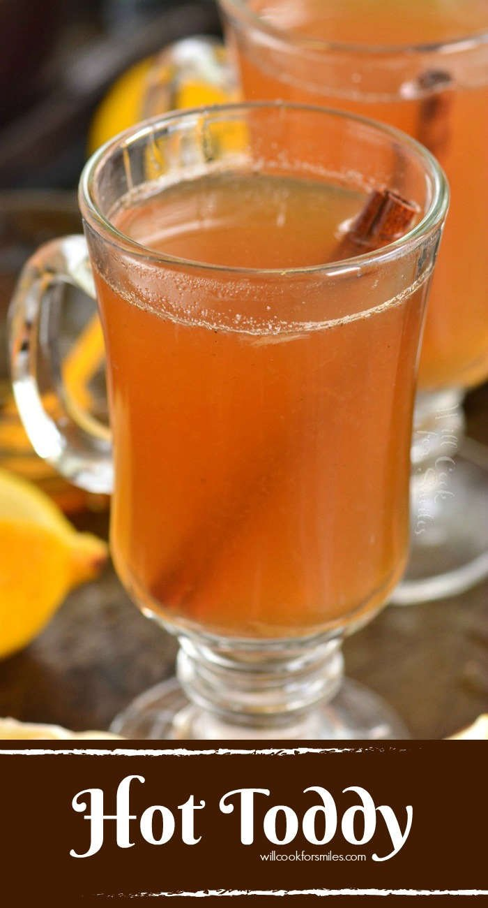 hot toddy in a glass with a cinnamon stick