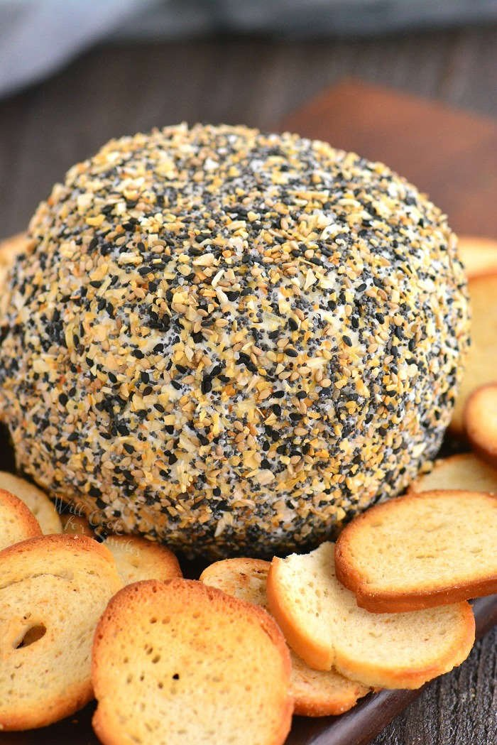 cheese ball on a board with bagel chips