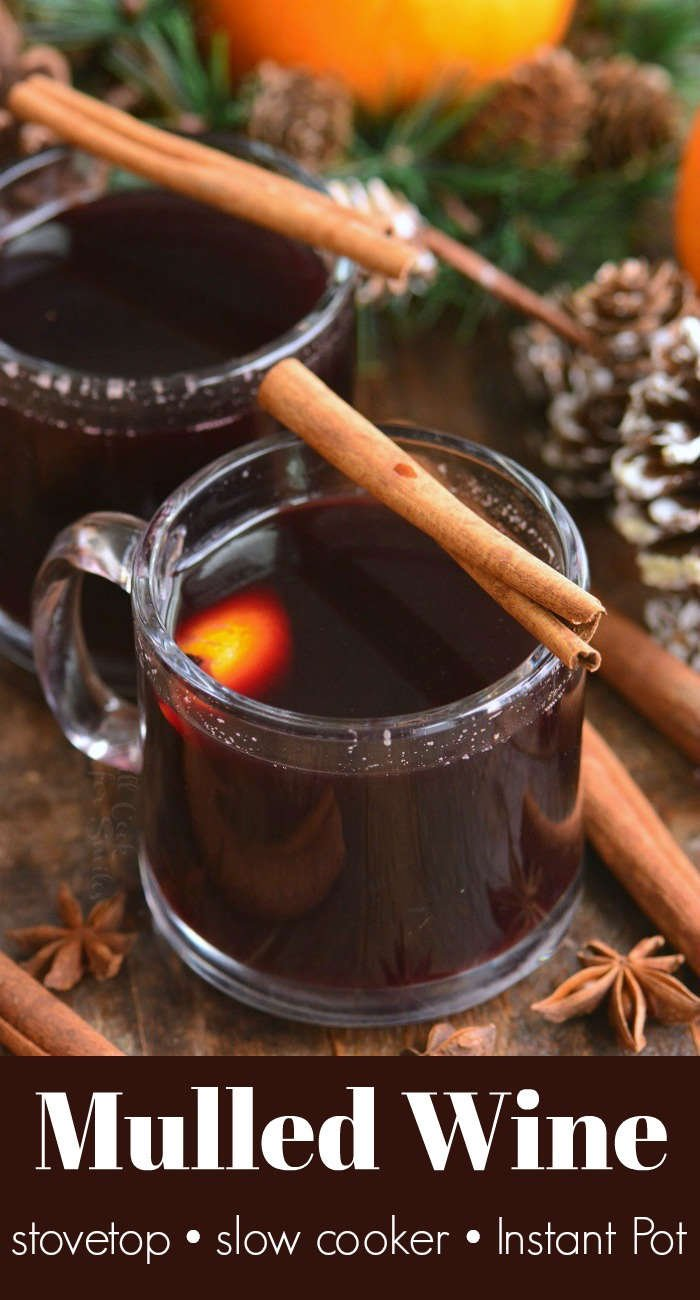 mulled wine in glass mug with cinnamon stick on top of glass