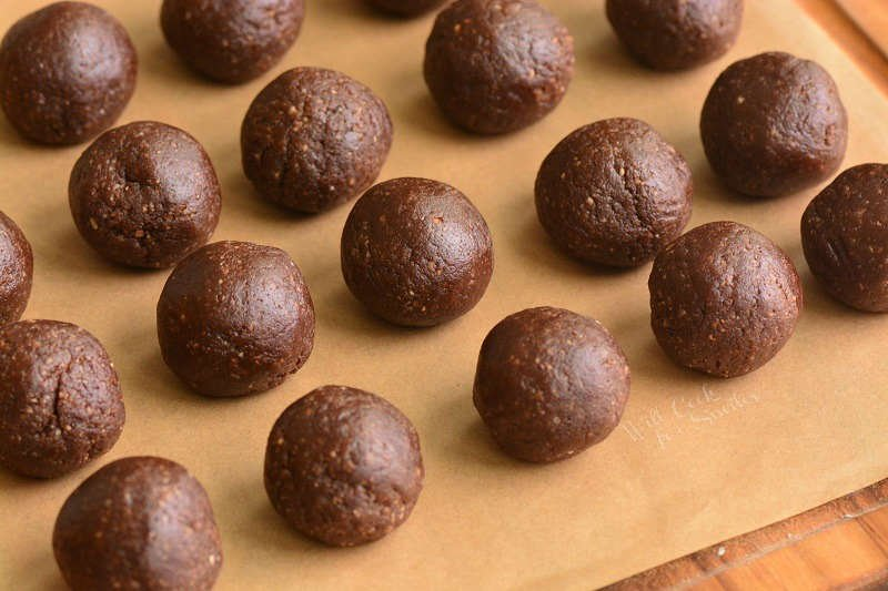 rolled rum balls on parchment paper