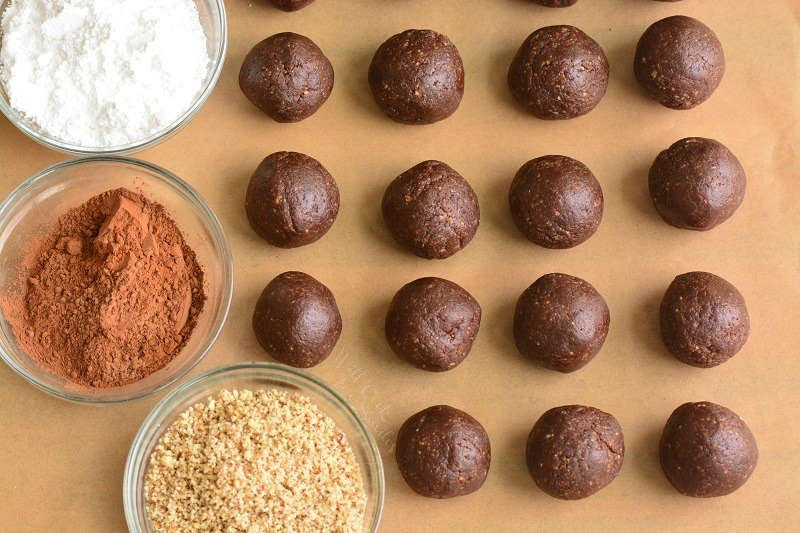 rum balls and toppings on parchment paper