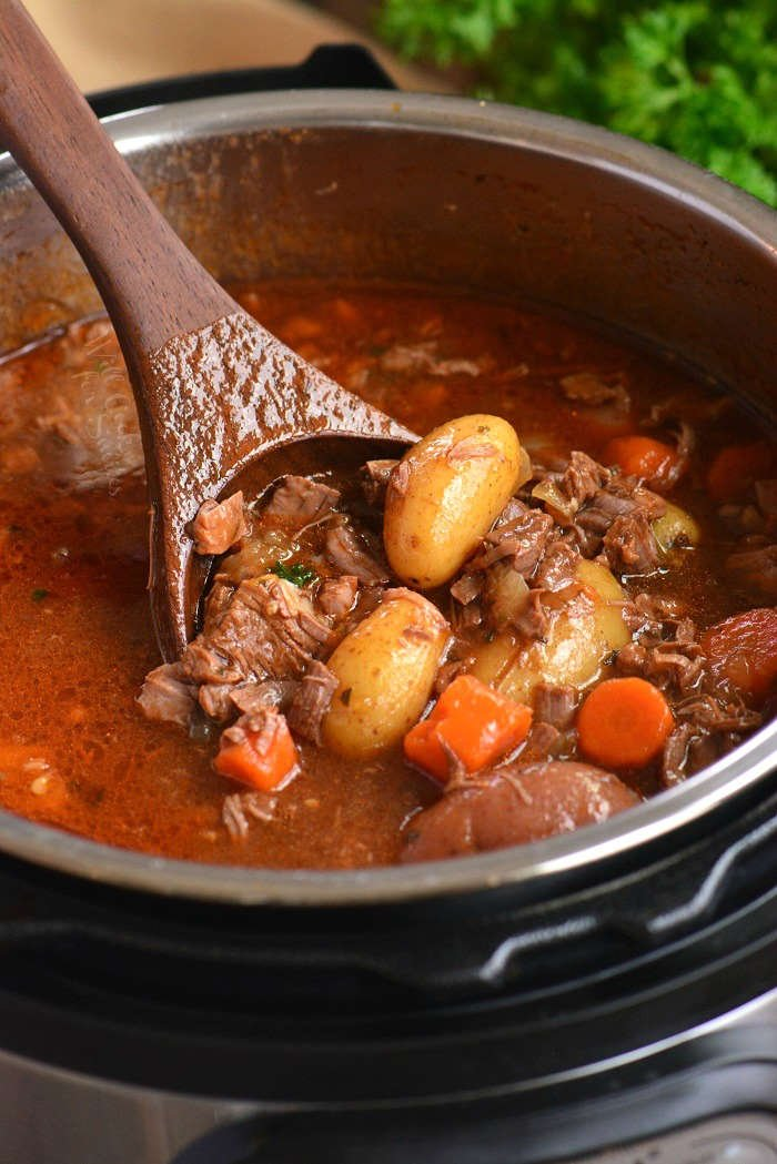 cooping out beef stew from the pot