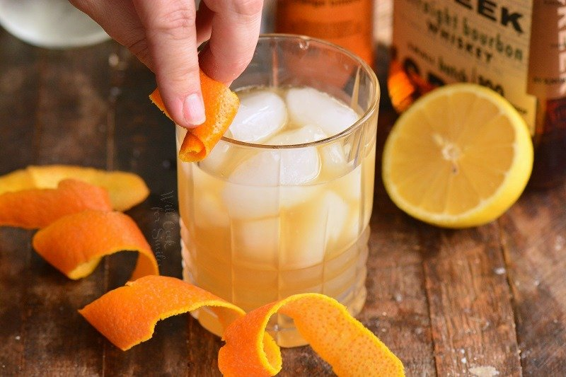 rub the rim of the glass with orange twist