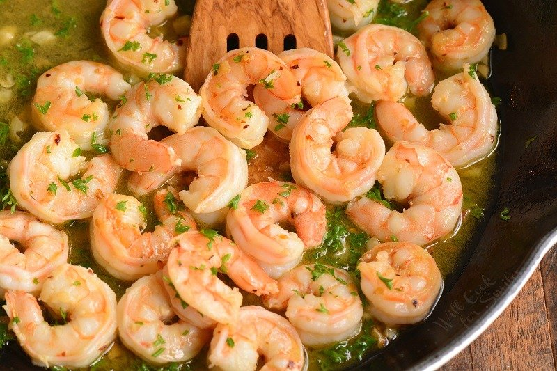 horizontal image of shrimp in the pan with sauce in a pan