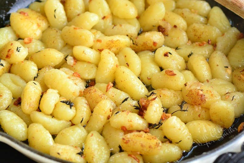 gnocchi in the pan with butter garlic and thyme
