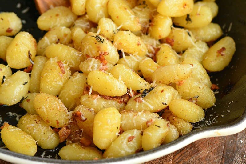 horizontal view of cooked gnocchi in the pan