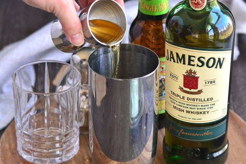 pouring Jameson into the shaker