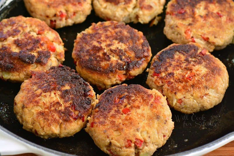 cooked salmon patties in the pan
