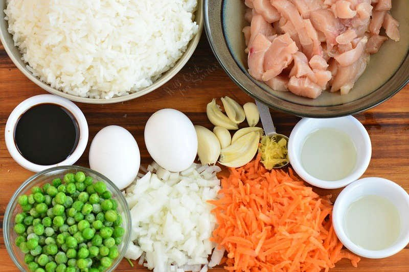 ingredients for chicken fried rice on the cutting board