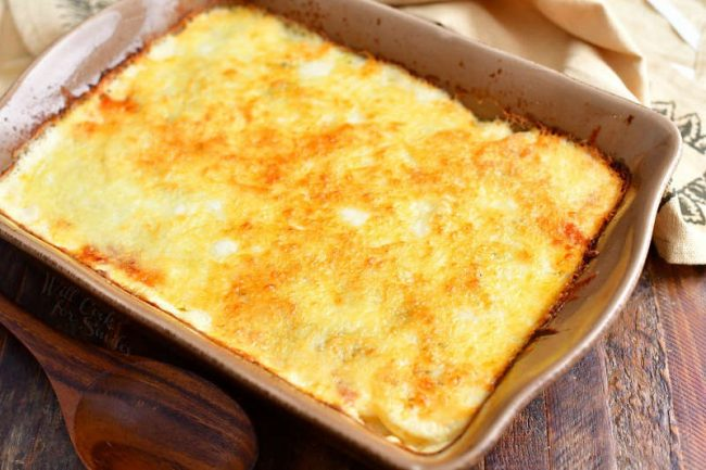 overhead photo: potatoes au gratin in casserole dish