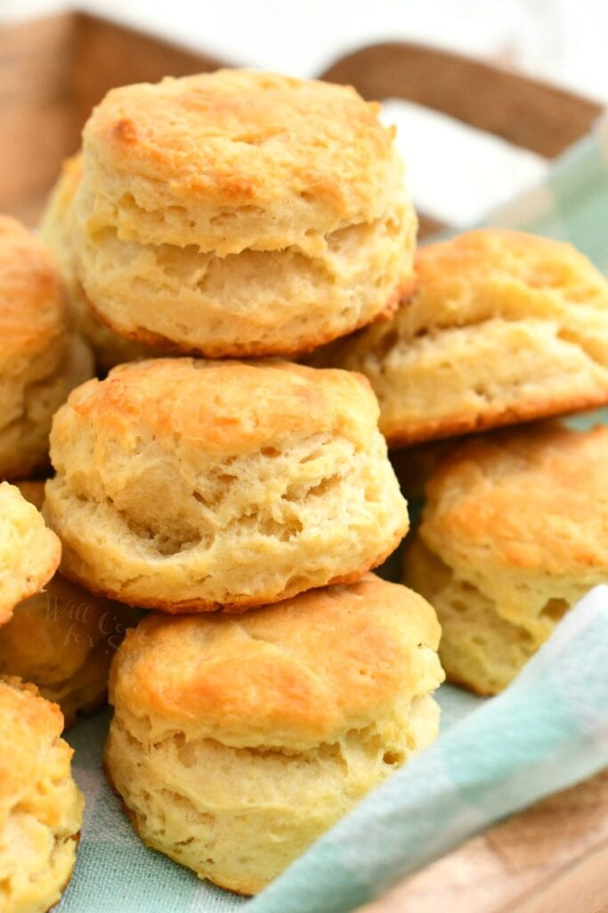 close up photo: cluster of tall, flaky biscuits