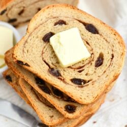 overhead photo: stacked slices of raisin bread - butter on top slice