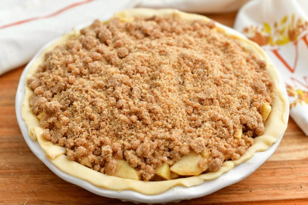 apple pie with crumble topping, ready for baking