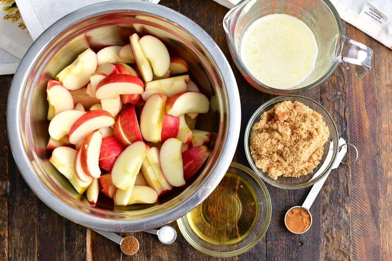 overhead photo: bowl of red apple slices and other ingredients for fried apples recipe
