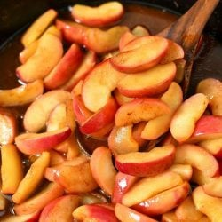 pan frying apple slices in cast iron skillet