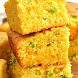 3 stacked squares of cheesy cornbread with green chili peppers