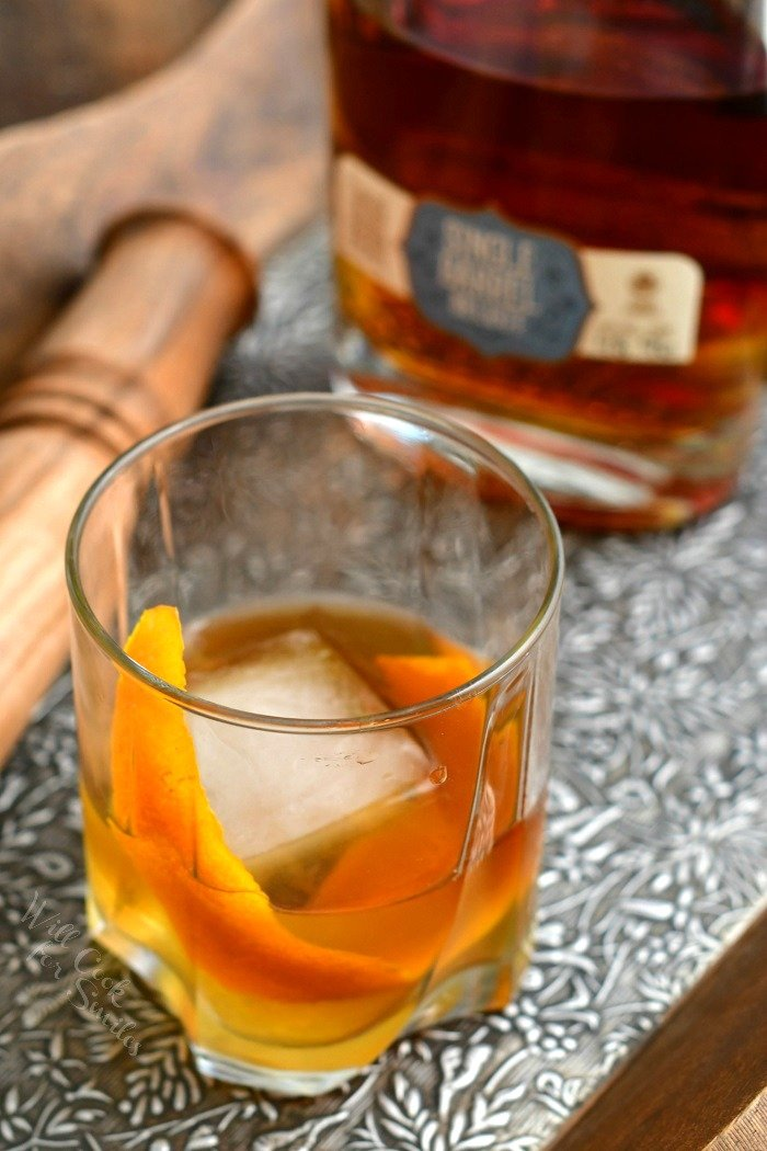 overhead photo of a bourbon Old Fashioned on the rocks with orange peel