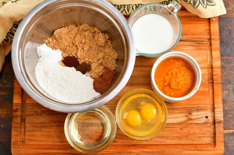 ingredients in mixing bowl and prep bowls to make an easy pumpkin bread recipe