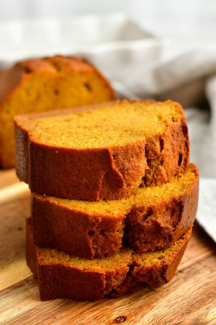 stacked slices of homemade quick bread made with pumpkin puree