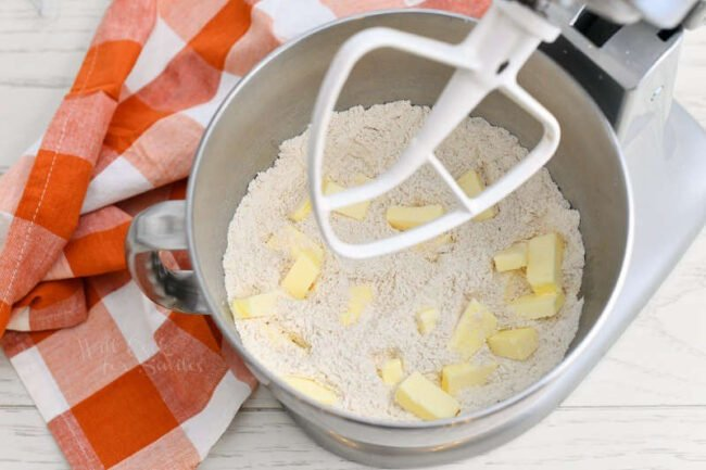 flour and cubes of butter in bowl of a stand mixer