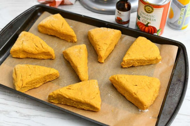 unbaked pumpkin scones on parchment lined baking sheet