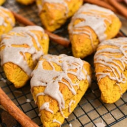 glazed pumpkin scones on black wire cooling rack