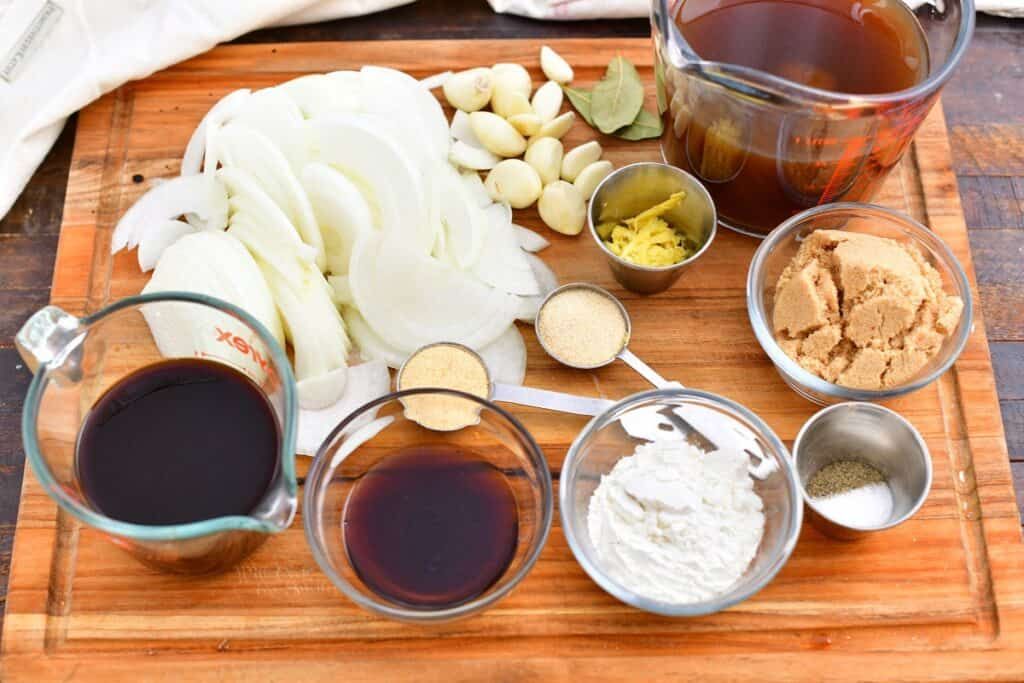 ingredients on cutting board, in measuring cups and bowls to make oven roasted brisket recipe