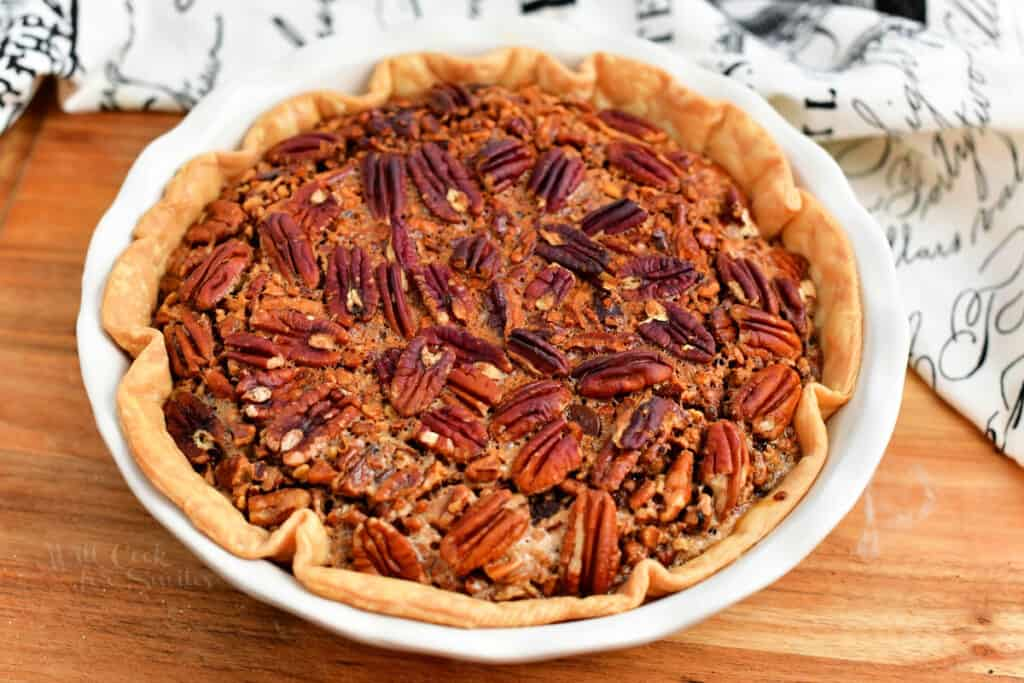 baked holiday pie topped with pecans for Thanksgiving