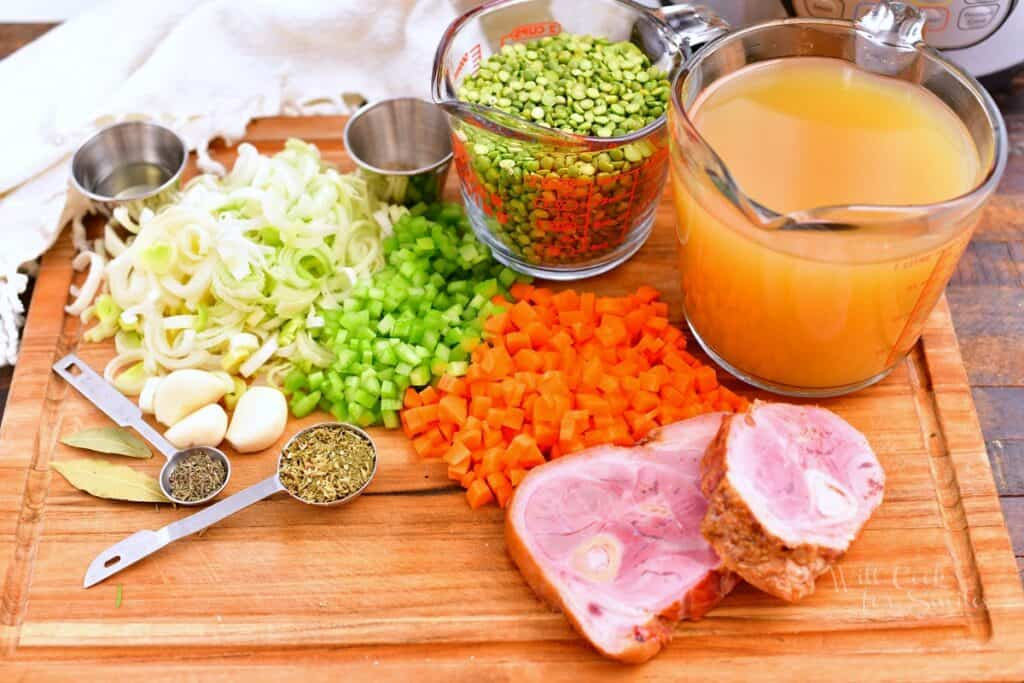 ingredients on a cutting board for making split pea soup with ham
