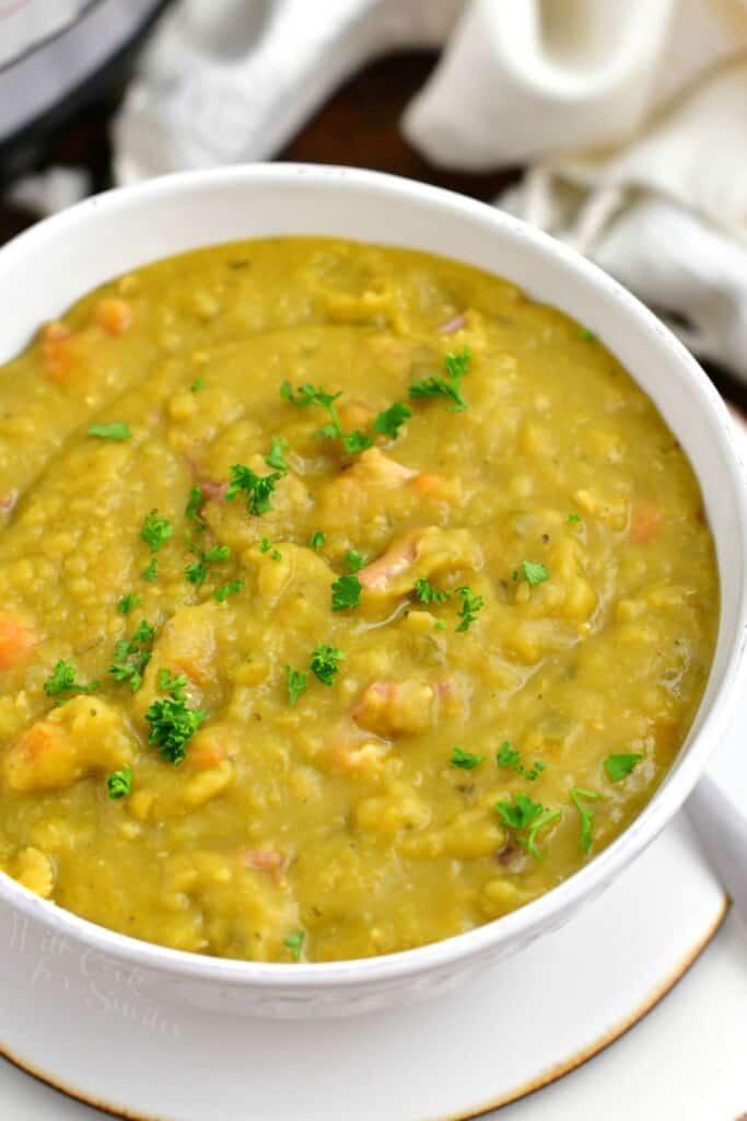 overhead photo: white soup bowl of Instant Pot split pea soup