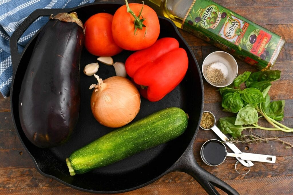 fresh eggplant, zucchini, onion, bell peppers, and tomatoes for a French stew recipe