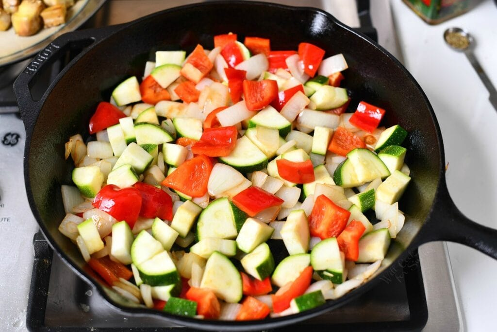 raw chopped garden vegetables in cast iron pan