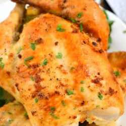 oven roasted chicken (whole) on white platter