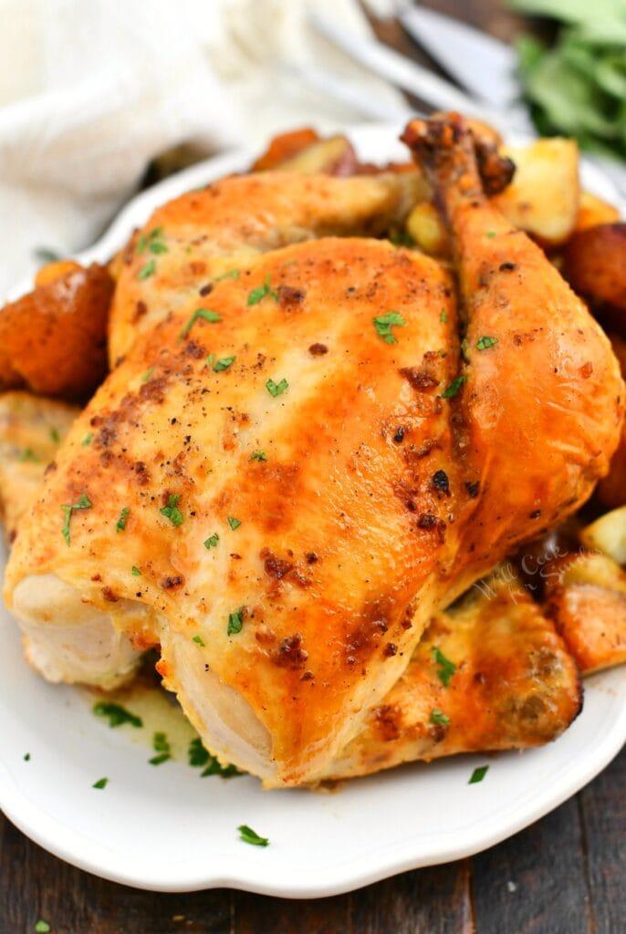 overhead photo: roasted chicken on white platter