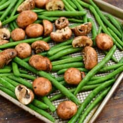 raw mushrooms and fresh green beans for making a roasted vegetables recipe