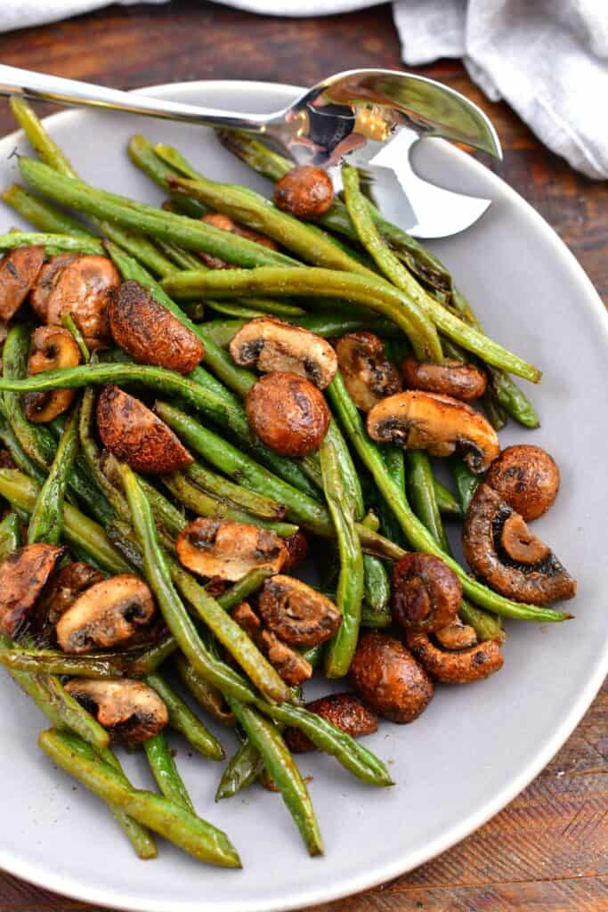 overhead photo: serving bowl of roasted fresh green beans and mushrooms