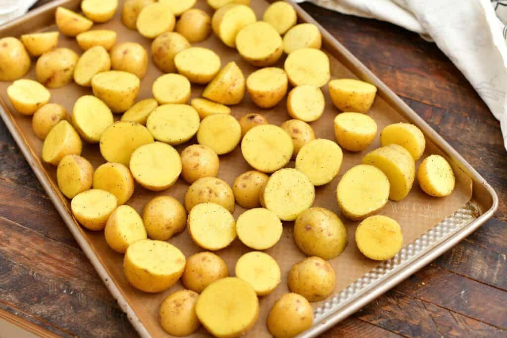 yellow potatoes on baking sheet, ready for roasting