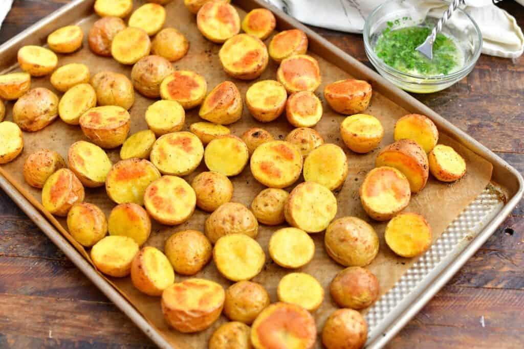 golden roasted potatoes on rimmed baking sheet