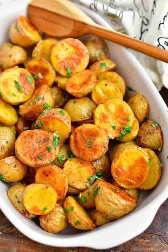 roasted potato side dish in white serving bowl