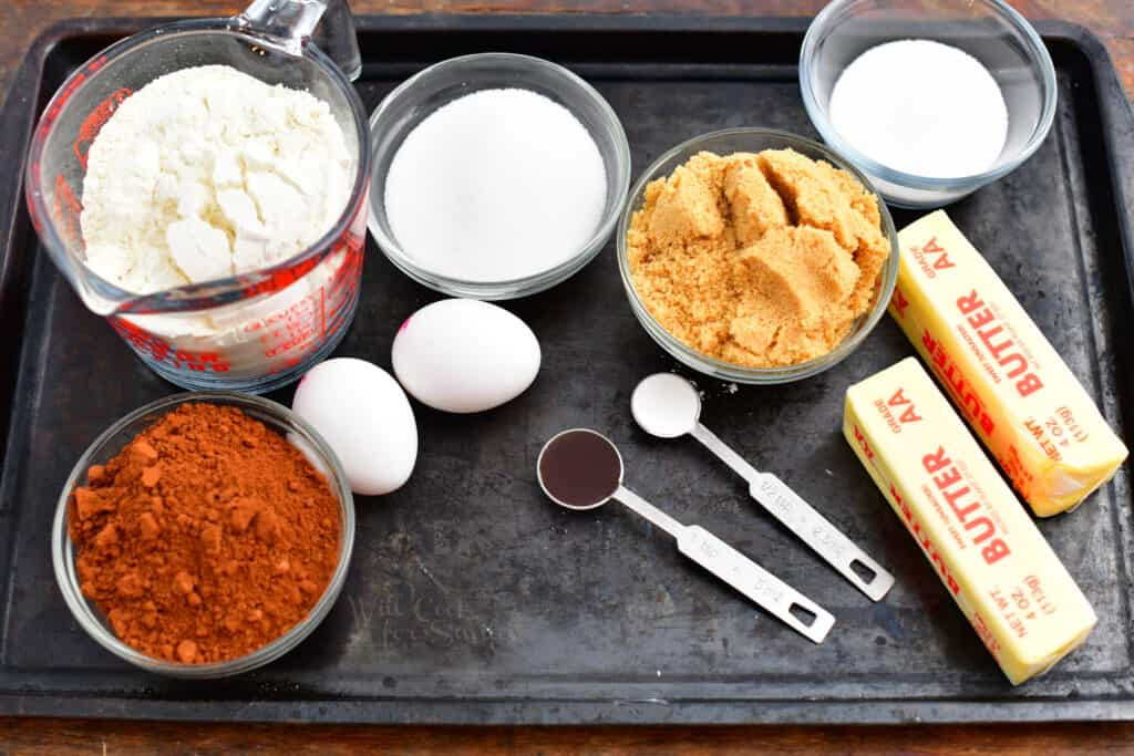 overhead image: cookie recipe ingredients in small bowls and measuring cups