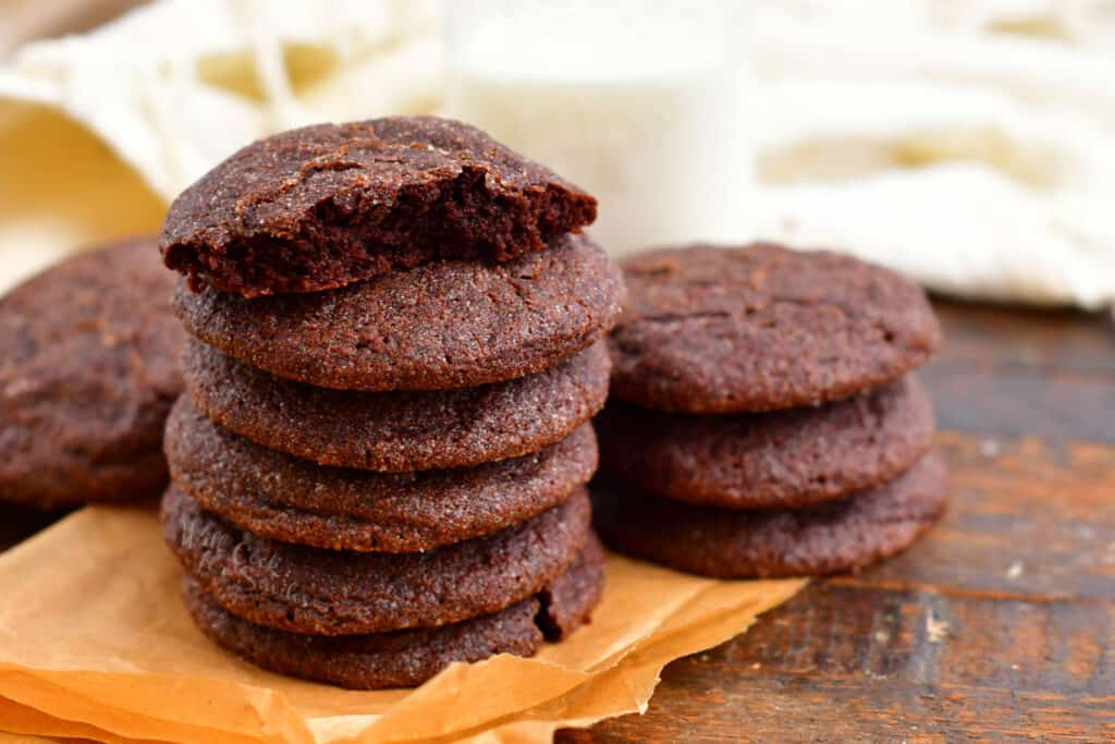 stack of soft chocolate cookies. Bite taken from the cookie on top