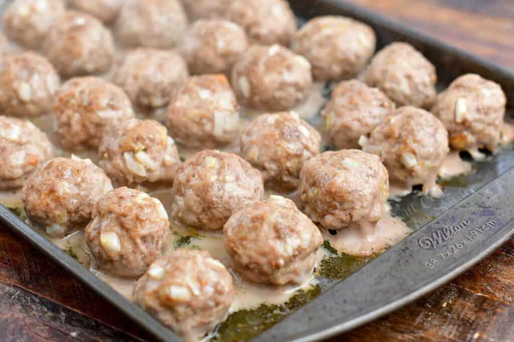 baked cocktail meatballs on baking sheet